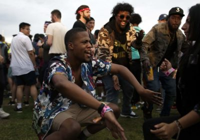 People dance during Anderson .Paak & The Free Nationals on Saturday at Boston Calling. (Hadley Green for WBUR)