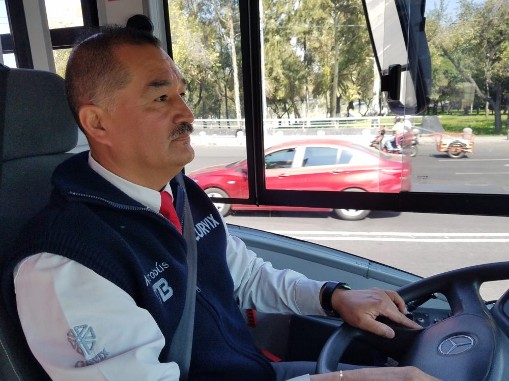 Jorge Mares has been a Metrobús driver for almost two years. The bus rapid transit system has its own dedicated lanes, which means Mares doesn't have to sit in traffic when he drives. (Zeninjor Enwemeka/WBUR)