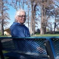Leigh Ann Harris sits on a park bench in Washington. (Eilís O'Neal for WBUR)