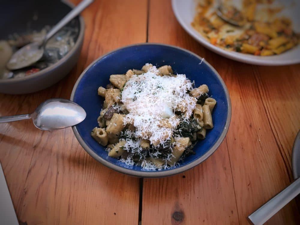 Spelt pasta with wild mushrooms, black cabbage and egg. (T.Tseng via flickr)