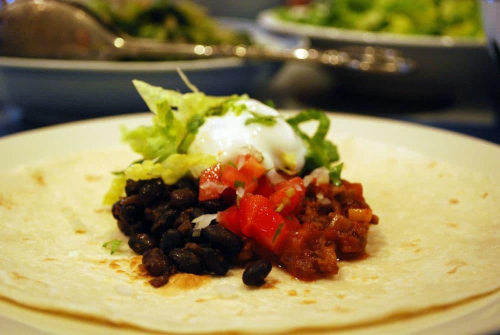 Turtle bean and chili con carne burrito. (Alpha via flickr)