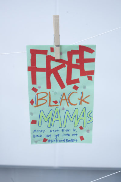 A flyer at the Wee Free Black Mamas bailout event. (OJ Slaughter for WBUR)