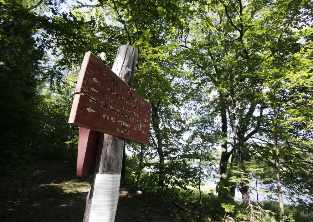 In this July 2011 photo, a sign directs hikers to nearby points of interest near the Kennebec River in Carrying Place Township, Maine. (Pat Wellenbach/AP)