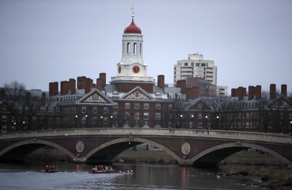 Rowers paddle down the Charles River near the campus of Harvard University in Cambridge, Mass. in March of 2017. (Charles Krupa/AP)