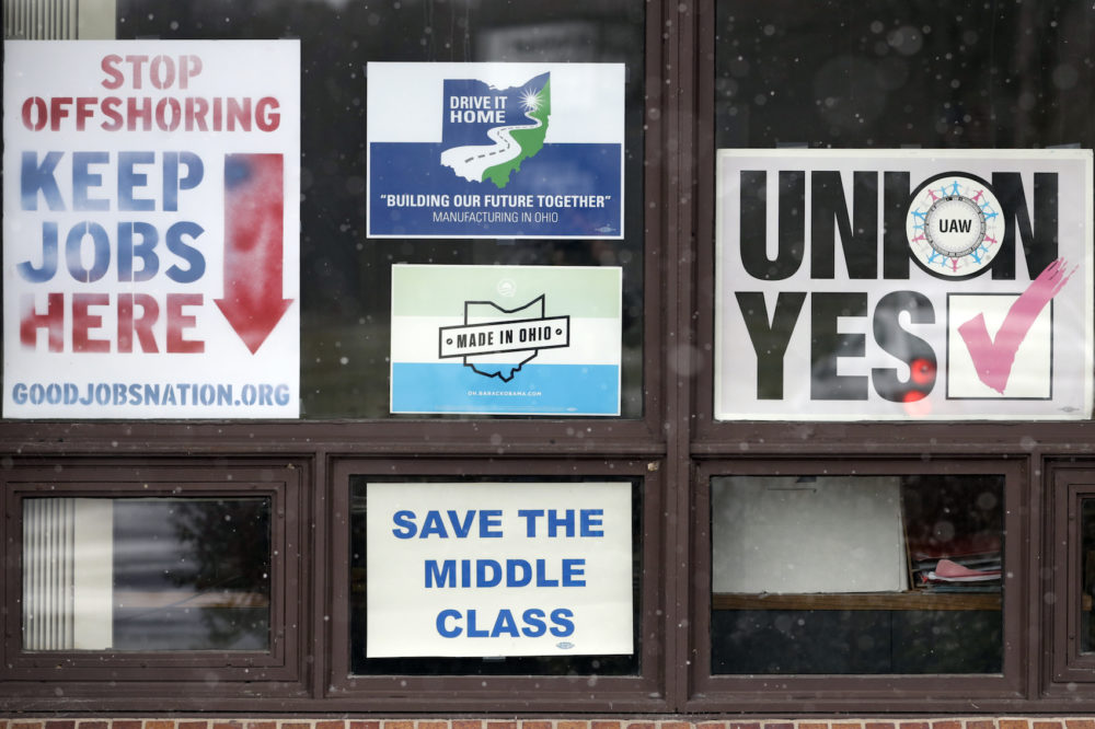 In this Nov. 27, 2018 photo, signs hang from windows at the UAW Local 1112 union hall, in Lordstown, Ohio. (Tony Dejak/AP)