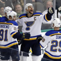 St. Louis Blues Captain Alex Pietrangelo (center) celebrates a goal scored in a game against the Dallas Stars in February. (Tony Gutierrez/AP Photo)