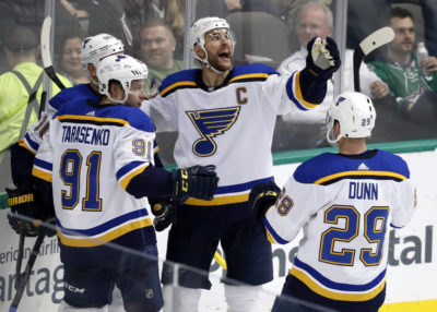 St. Louis Blues Captain Alex Pietrangelo (center) celebrates a goal scored in a game against the Dallas Stars in February. (Tony Gutierrez/AP Photo)