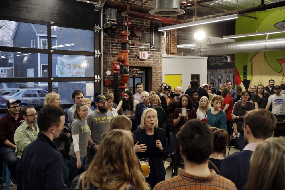 Gillibrand, middle, speaks during a campaign meet-and-greet on March 15 at To Share Brewing in Manchester, N.H. (Elise Amendola/AP)