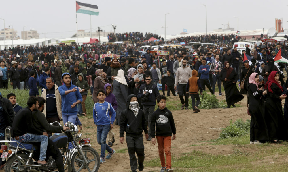 Protestors march toward the Gaza Strip's border with Israel, marking first anniversary of Gaza border protests east of Gaza City, Saturday, March 30, 2019.  (Adel Hana/AP)