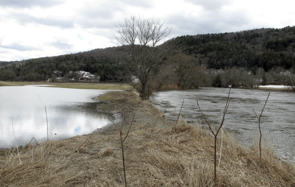 A swollen Winooski River flows past farm fields on Tuesday, April 16, 2019. (Lisa Rathke/AP)