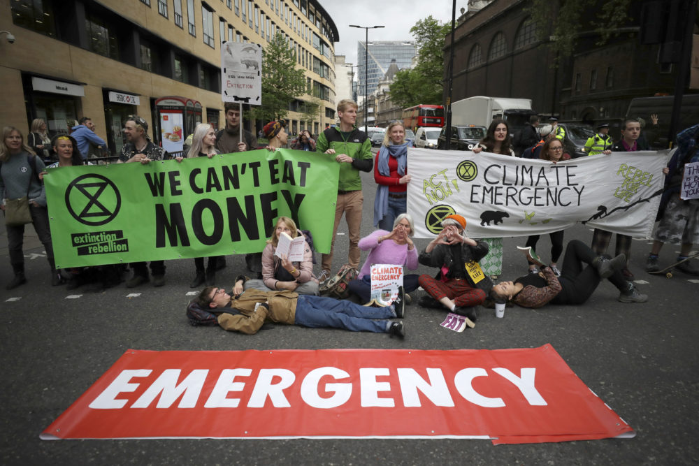Extinction Rebellion climate change protesters briefly block the road in the City of London, Thursday, April 25, 2019. (Matt Dunham/AP)