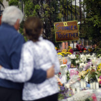 A couple embrace near a growing memorial across the street from the Chabad of Poway synagogue in Poway, Calif., on Monday,, April 29, 2019. (Greg Bull/AP)