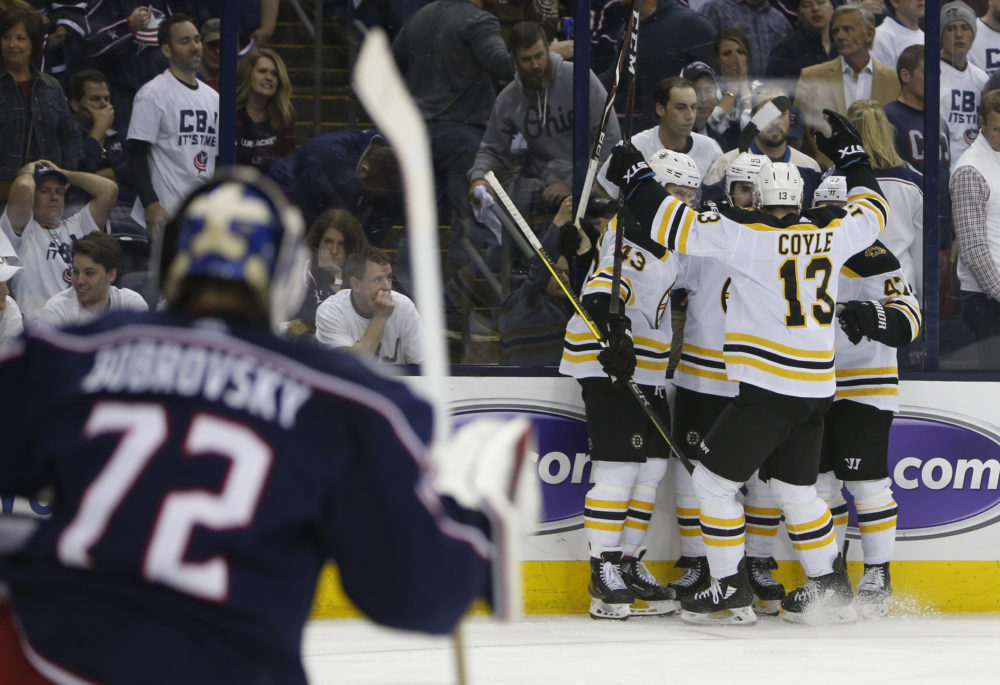 Boston Bruins players celebrate their goal against the Columbus Blue Jackets during the third period of Game 6 of an NHL hockey second-round playoff series Monday, May 6, 2019. (Jay LaPrete/AP)