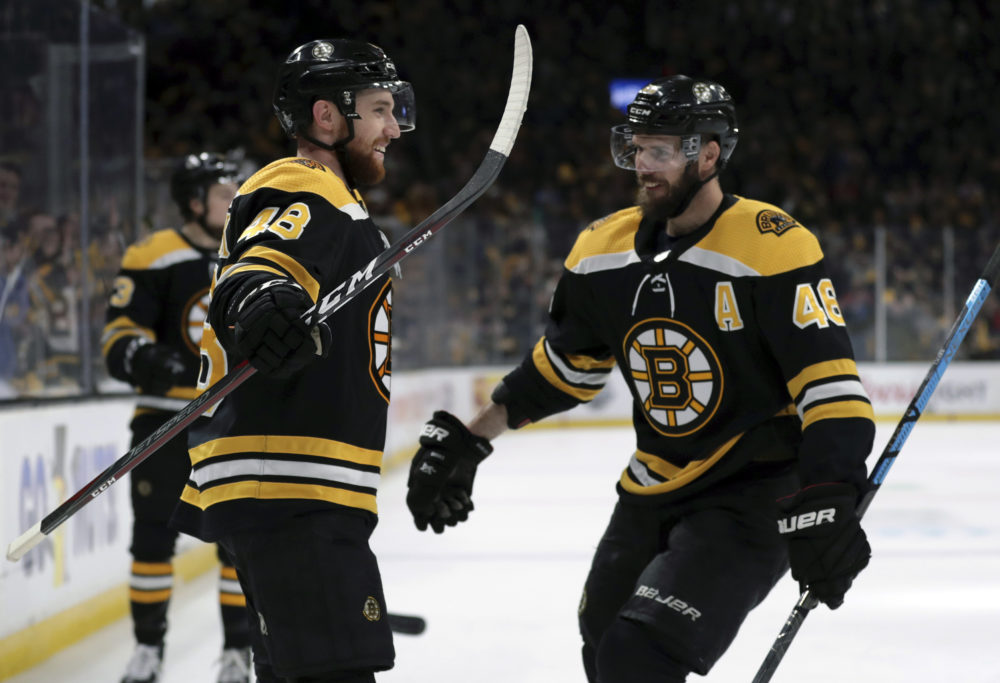 Boston Bruins' Matt Grzelcyk, left, celebrates his goal against the Carolina Hurricanes with David Krejci during the second period in Game 2 of the NHL hockey Stanley Cup Eastern Conference final series, Sunday, May 12, 2019, in Boston. (Charles Krupa/AP)
