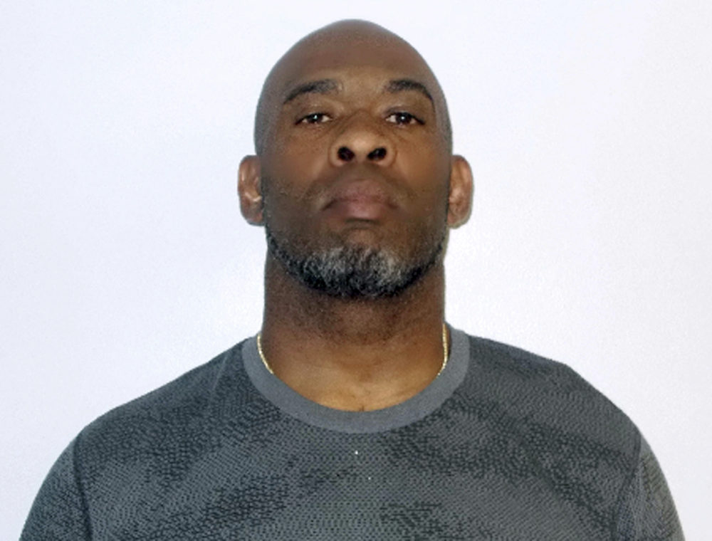 Greg Spires, a former NFL football player accused of violating a protective order in Concord, N.H. (Concord Police Department via AP)