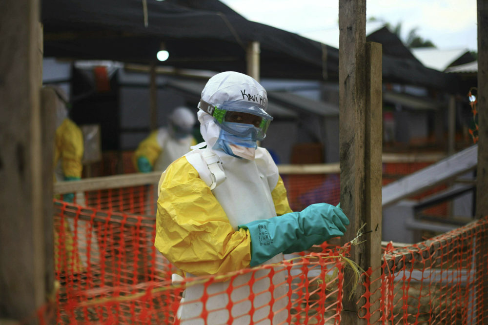 In this Tuesday April, 16, 2019 file photo, an Ebola health worker is seen at a treatment center in Beni, Eastern Congo. (Al-hadji Kudra Maliro, file/AP)