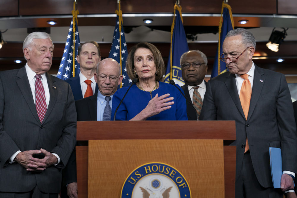 Speaker of the House Nancy Pelosi, D-Calif., center, Senate Minority Leader Chuck Schumer, D-N.Y., right, and other congressional leaders, react to a failed meeting with President Trump at the White House on infrastructure Wednesday. (J. Scott Applewhite/AP)