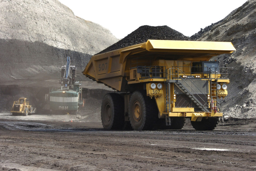 In this April 4, 2013, file photo, a truck carrying 250 tons of coal hauls the fuel to the surface of the Spring Creek mine near Decker, Mont. (Matthew Brown, File/AP)