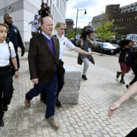 Chef Mario Batali departs Boston federal court Friday after pleading not guilty to an allegation that he forcibly kissed and groped a woman at a Boston restaurant in 2017. (/Josh Reynolds/AP)