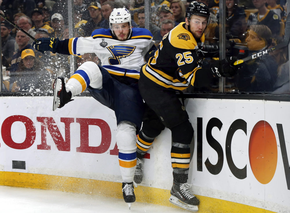 St. Louis Blues' Sammy Blais, left, and Boston Bruins' Brandon Carlo crash into the boards during the third period in Game 2 of the NHL hockey Stanley Cup Final, Wednesday, May 29, 2019, in Boston. (Michael Dwyer/AP)