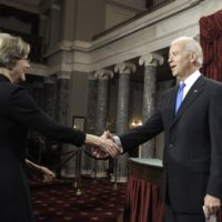 Eight years after they clashed over a bankruptcy bill, then-Vice President Joe Biden welcomes Sen. Elizabeth Warren for her swearing-in ceremony on Jan. 3, 2013. (Cliff Owen/AP)