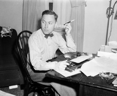 """This Nov. 11, 1940 file photo shows playwright Tennessee Williams at his typewriter in New York.  Williams' """"The Eye That Saw Death,"""" will appear in the spring issue of The Strand Magazine.   """"The Eye That Saw Death"""" has a fable-like quality even as its plot recalls Poe's """"The Tell-Tale Heart.""""  (AP Photo/Dan Grossi, File)"""