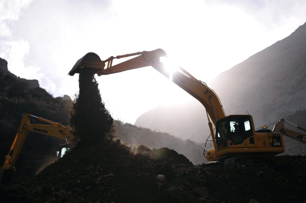 In this photo released by China's Xinhua News Agency, an excavator works at the accident site in Maizhokunggar County of Lhasa, southwest China's Tibet Autonomous Region, Sunday, March 31, 2013. (Xinhua, Liu Kun/AP)