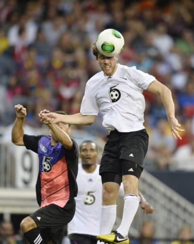 Matt Eliason goes up for a header against Messi. (Brian Kersey/AP)