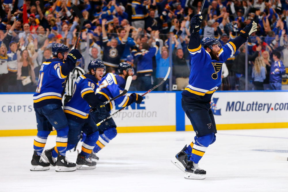 The St. Louis Blues celebrate after scoring the game-winning goal in double overtime in Game Seven of the 2019 Western Conference Finals. (Dilip Vishwanat/Getty Images)
