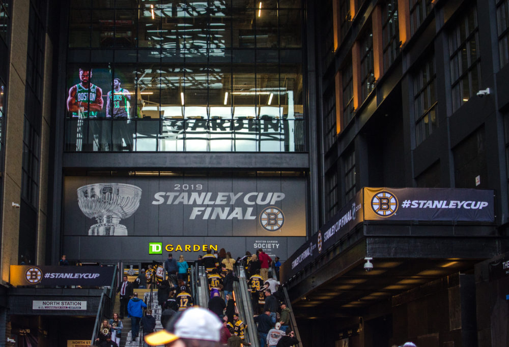 Bruins fans stream into TD Boston Garden to watch a scrimmage in the week before the Stanley Cup Final against the St. Louis Blues. (Sharon Brody/WBUR)