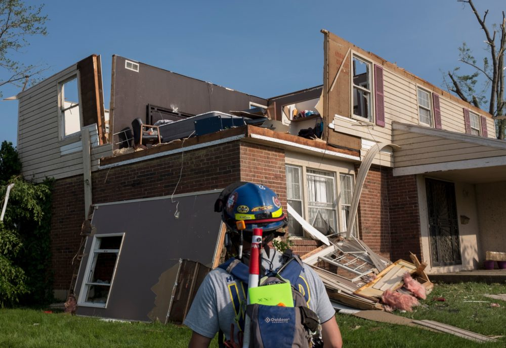 A member of search and rescue inspects a home in Trotwood, Ohio, on Tuesday after powerful tornadoes ripped through the U.S. state overnight, causing at least one fatality and widespread damage and power outages. (Seth Herald/AFP/Getty Images)