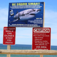 A shark public awareness sign posted at Newcomb Hollow Beach in Wellfleet (Quincy Walters/WBUR)