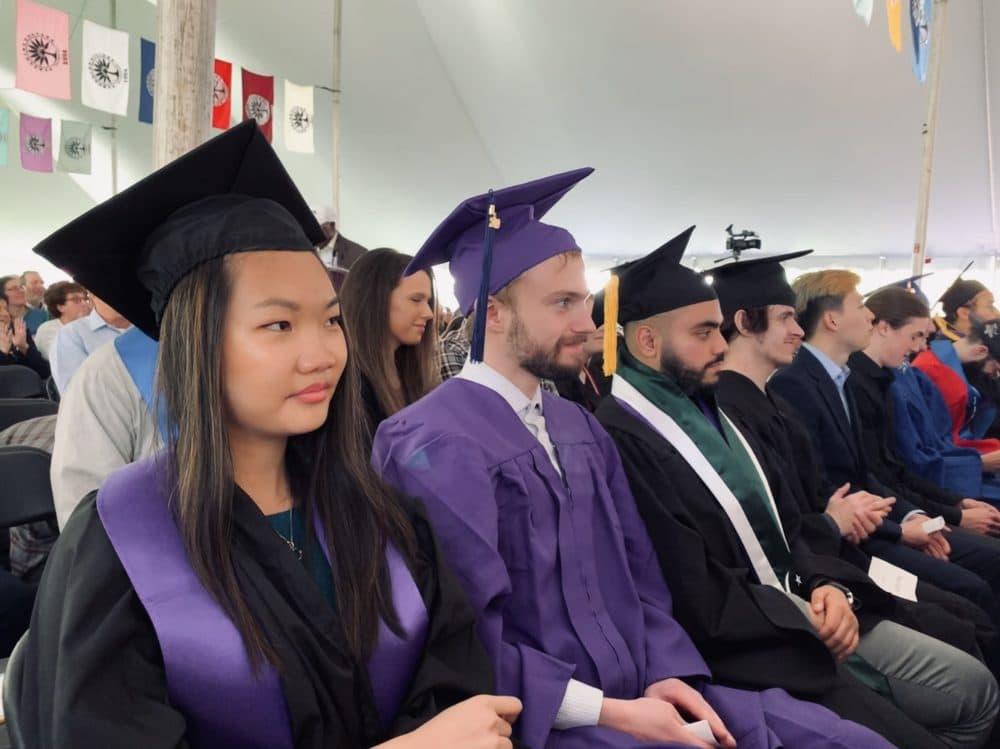Hampshire College students listen to graduation speakers, including interim president Ken Rosenthal, cancer survivor Ericka Hart and legal studies Professor Jennifer Hamilton. (Carrie Jung/WBUR)