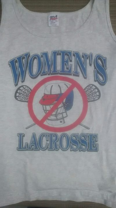 A shirt opposing the use of helmets in girls' lacrosse. (Courtesy Kathy Tomassetti)