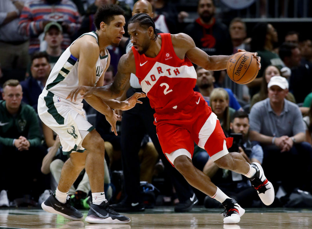 Kawhi Leonard dribbles the ball while being guarded by Malcolm Brogdon of the Milwaukee Bucks in the fourth quarter during Game Five of the Eastern Conference Finals of the 2019 NBA Playoffs. (Jonathan Daniel/Getty Images)