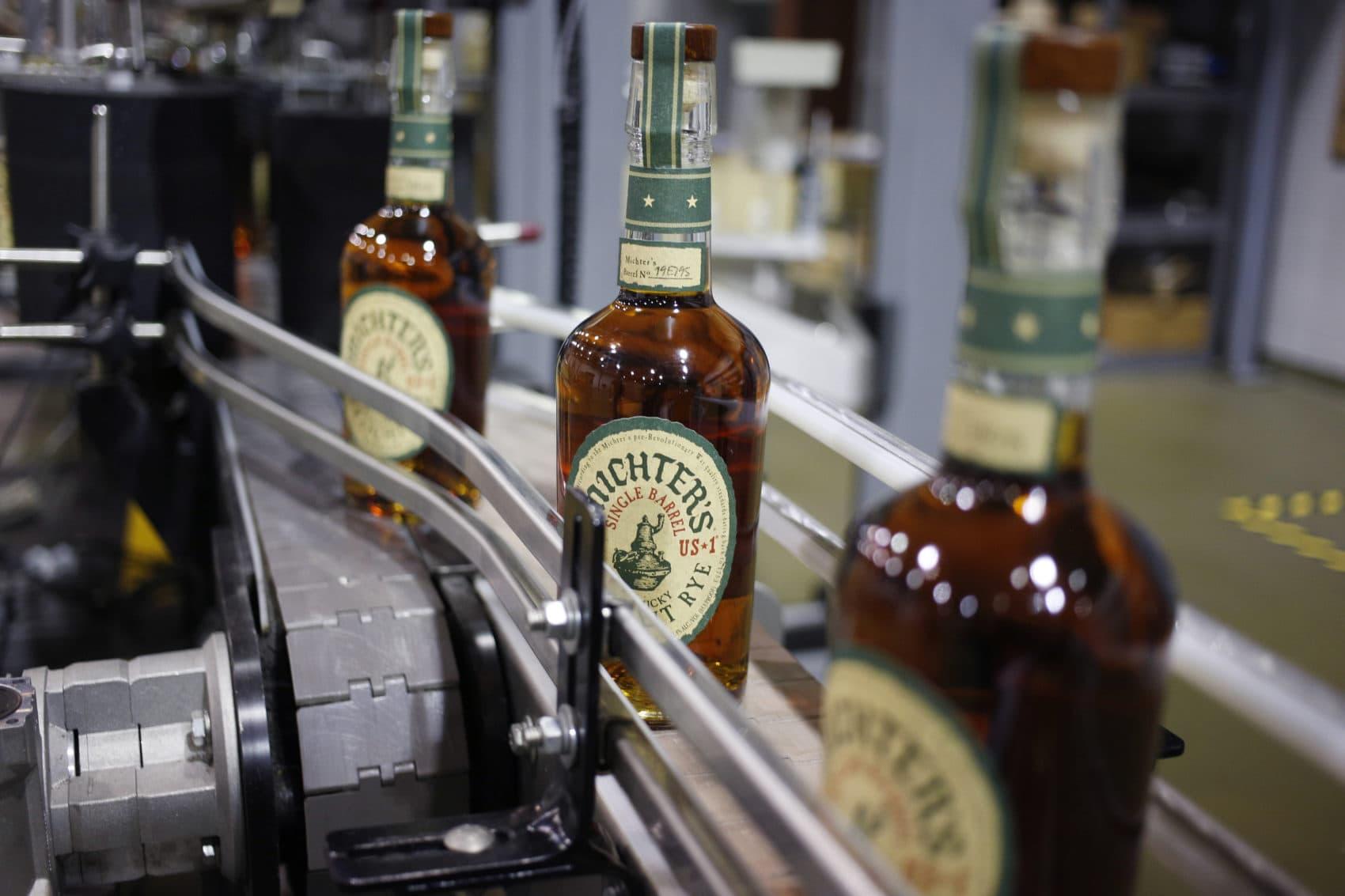 Bottles of Michter's Rye move down a conveyor belt at Michter's Shively Distillery in Louisville, Ky. (Luke Sharrett for Here & Now)