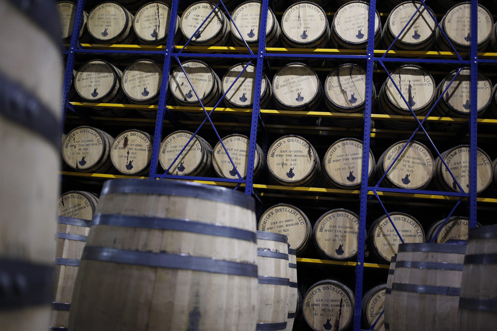 Barrels of Michter's Kentucky Straight Bourbon age in a warehouse at Michter's Shively Distillery in Louisville, Ky. (Luke Sharrett for Here & Now)