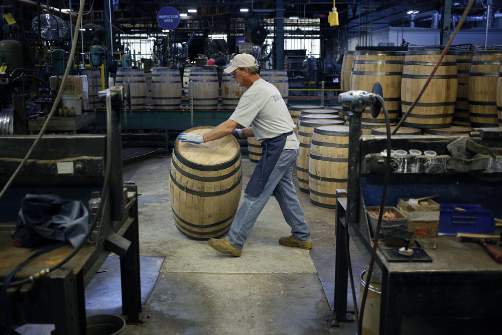 A cooper assembles a white oak bourbon barrel at the Brown-Forman Cooperage in Louisville, Ky.(Luke Sharrett for Here & Now)