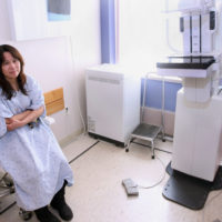 Yan Ling Zhong of Boston waits for a digital mammogram at Tufts Medical Center in Boston in this file photo. (Bizuayehu Tesfaye/AP Images for College of American Pathologists/See, Test and Treat)