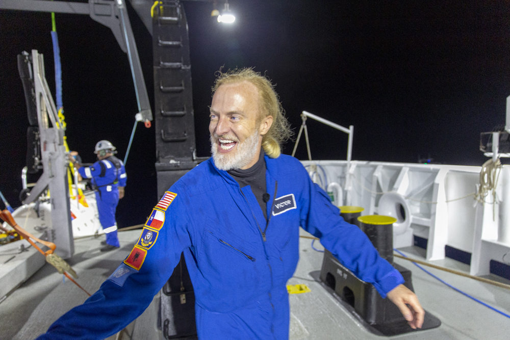 """Victor Vescovo emerges from his submersible """"Limiting Factor"""" after a successful dive to the deepest known point in the Challenger Deep. (Tamara Stubbs/Courtesy of Discovery)"""