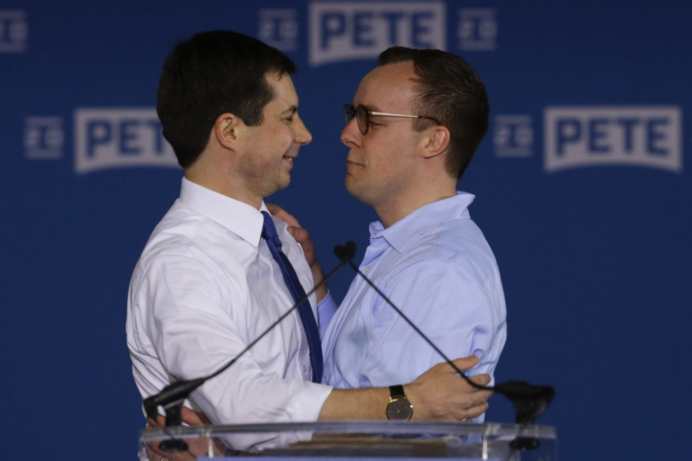 Pete Buttigieg is joined by his husband Chasten Glezman after he announced that he will seek the Democratic presidential nomination during a rally in South Bend, Ind., April 14, 2019. (Michael Conroy/AP)