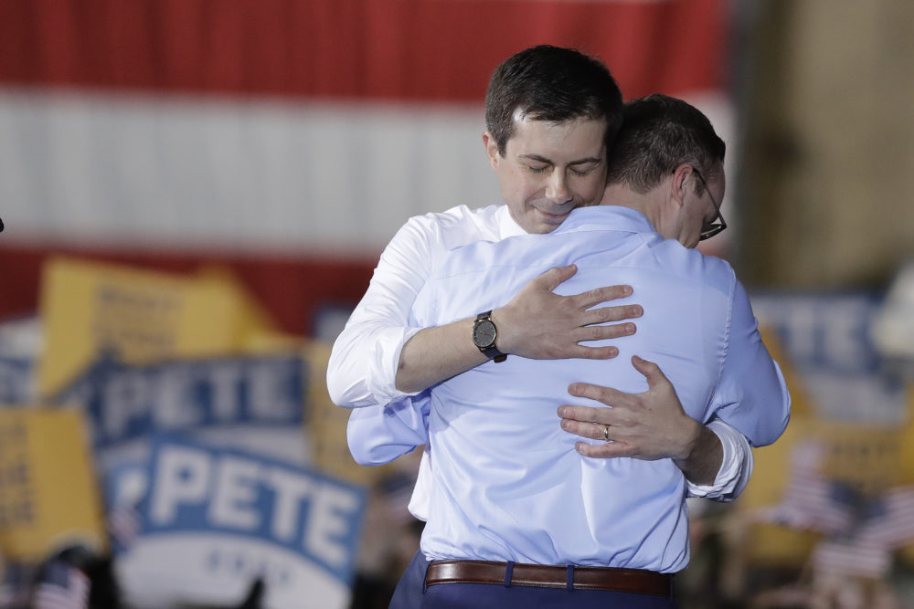 South Bend Mayor Pete Buttigieg, left, hugs his husband, Chasten Glezman, after Buttigieg announces that he will seek the Democratic presidential nomination during a rally, April 14, 2019, in South Bend, Ind. (Darron Cummings/AP)