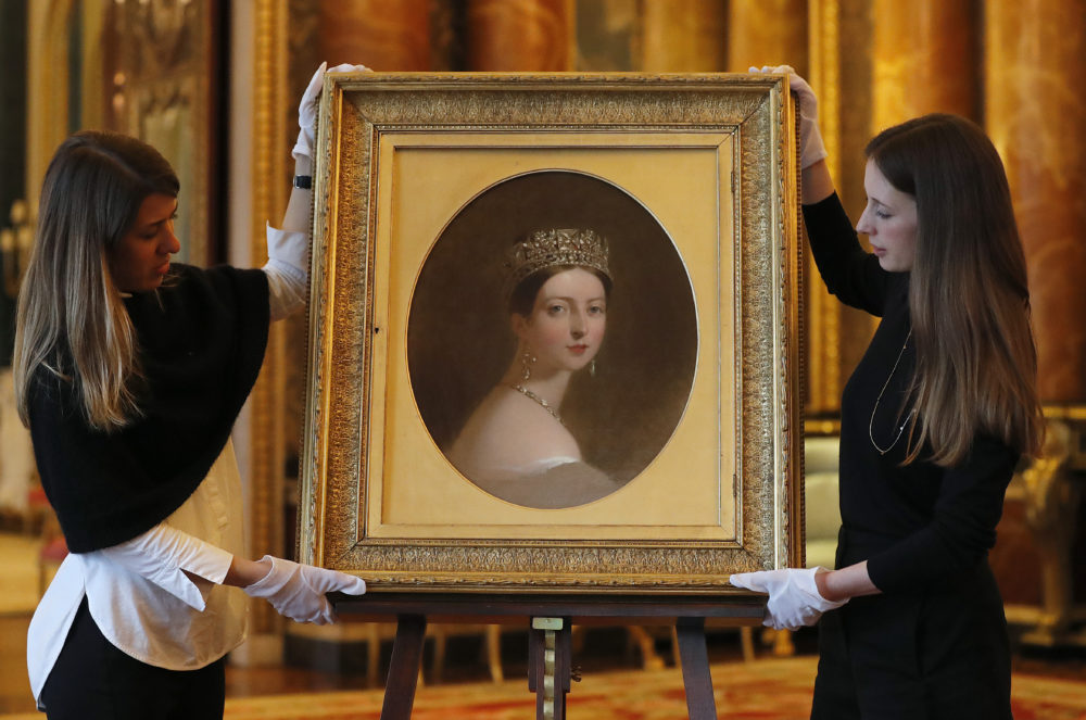 Last month, staff members arranged Thomas Sully's portrait of Queen Victoria, which is part of an exhibition to mark the 200th anniversary of the birth of the queen (1819–1901) this year at Buckingham Palace in London. (Frank Augstein/AP)