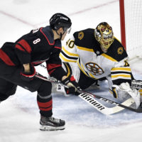 Tuukka Rask stuffs Saku Maenalanen of the Carolina Hurricanes during Game 3 of the 2019 Eastern Conference Finals. (Grant Halverson/Getty Images)