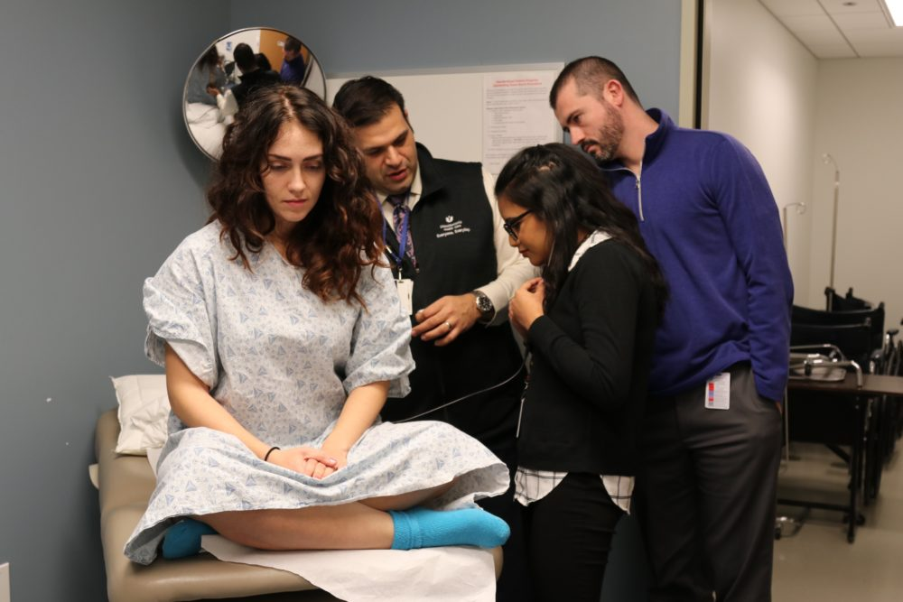 UMass Medical School students with standardized patients during training. (UMass Medical School, Megan Bard)