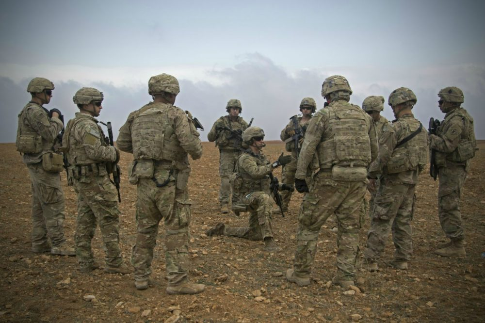 U.S. Soldiers gather for a brief during a combined joint patrol rehearsal in Manbij, Syria, Nov. 7, 2018. (U.S. Army photo by Spc. Zoe Garbarino)