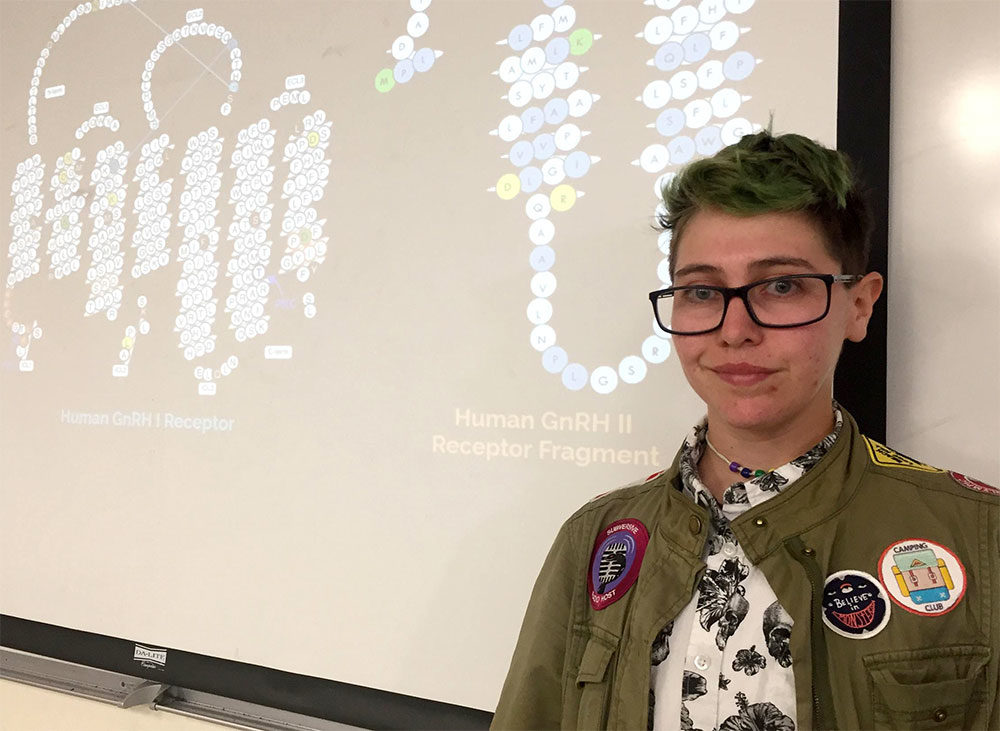 Hampshire College student Savvy Cornett presents a final project, known as Division III. (Karen Brown/NEPR)