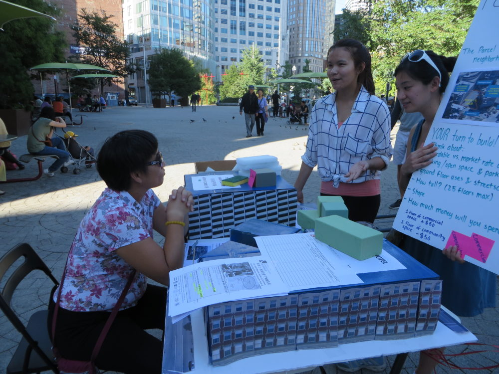 The author, standing in a white shirt, while working to educate residents about Parcel 12 in Mary Soo Hoo Park in Chinatown. (Courtesy)