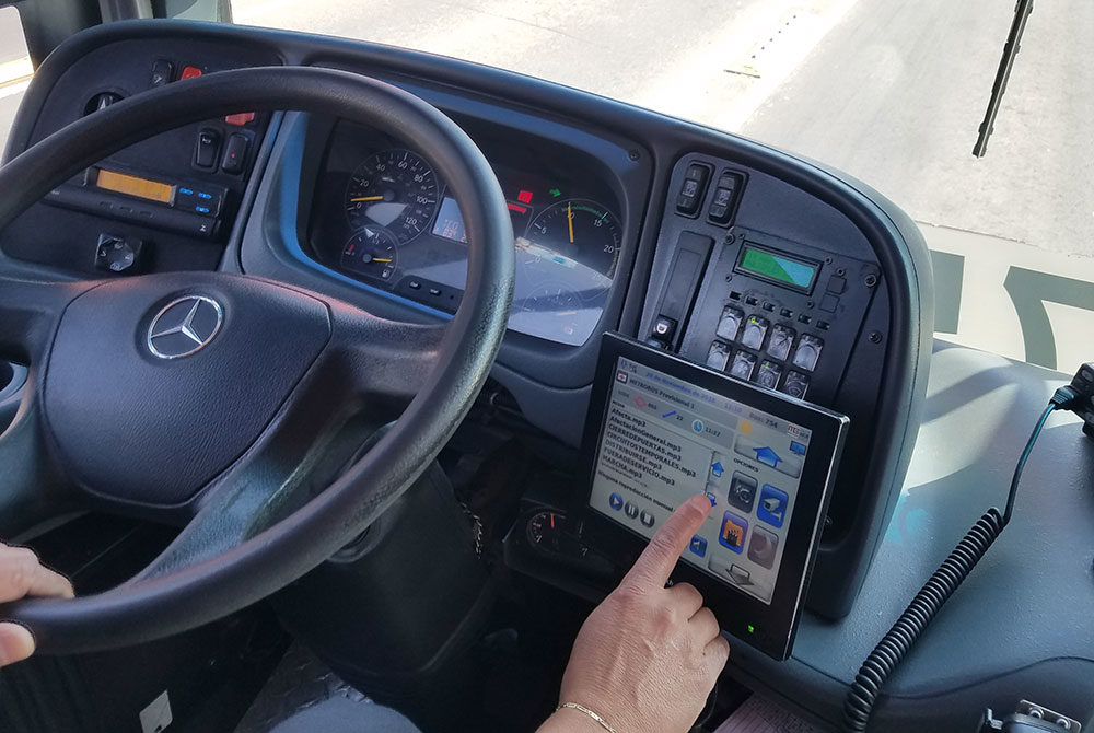 Metrobús driver Jorge Mares pushes a button on his screen to play a prerecorded announcement to his passengers. (Zeninjor Enwemeka/WBUR)