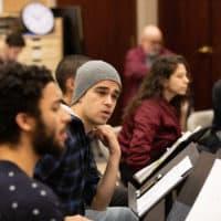 "Jakeim Hart, Abubakr Ali, Dana Saleh Omar, and Layan Elwazani in rehearsal for ""We Live in Cairo."" (Courtesy Evgenia Eliseeva and American Repertory Theater)"